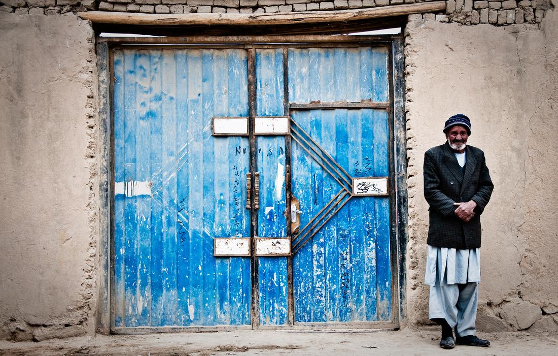 Man and the blue door