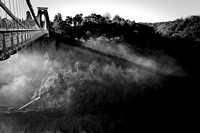 black and white image of Clifton Suspension bridge whilst surrounded by fog
