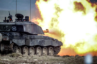 A challenger 2 main battle tank fires on salisbury plain
